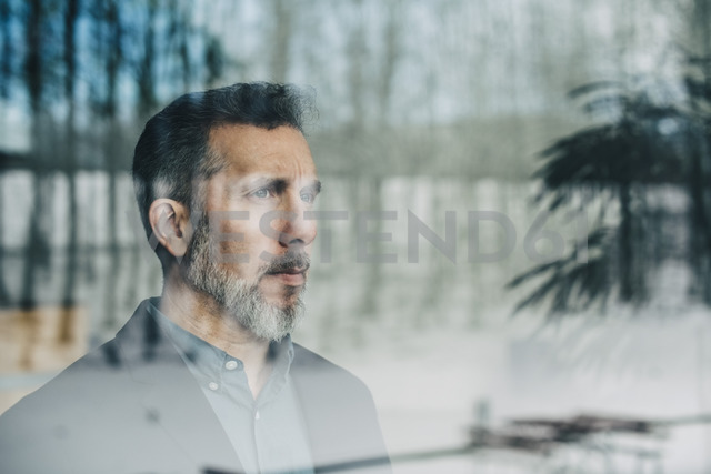 Close-up of thoughtful businessman seen through glass window at office - MASF08350 - Maskot/Westend61