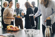 Business people having drinks and fruits during conference in office - MASF08401