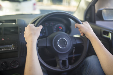 Male hands in car holding steering wheel - ZEF15786