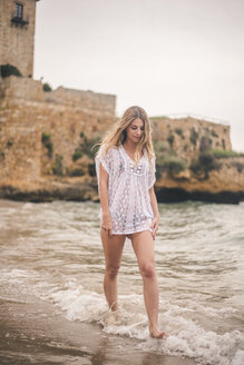 Beautiful young woman wading in water on the beach - ACPF00112