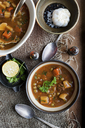 Bowl of stew with garlic and lemon - CUF40196