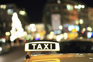 Close up of illuminated taxi sign - CUF40262