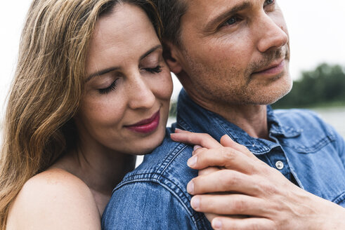 Close-up of affectionate couple outdoors - UUF14469