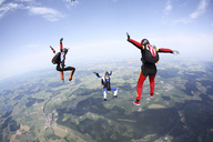 Three skydivers free falling above Leutkirch, Bavaria, Germany - CUF40373