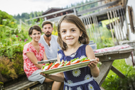 Young family preparing picnic lunch, Tyrol, Austria - CUF40385
