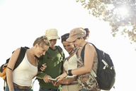 Group of young adult friends looking at map, Cape Town, South Africa - CUF40484