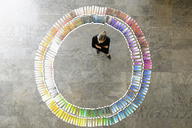 Businesswoman examining paint swatches - CUF40715