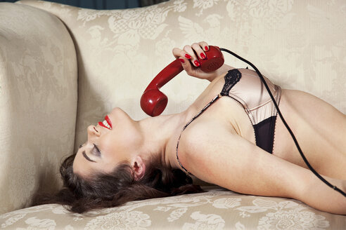 Woman in lingerie holding phone - CUF40862