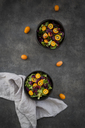 Bowl of mixed green salad with red cabbage, kumquat and pomegranate seeds - LVF07258