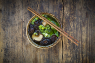 Bowl of Japanese miso soup with sugar peas, shitake mushrooms, tofu and mung sprouts - LVF07276