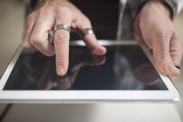 Close-up of man using tablet - ZEF15868