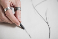 Close-up of artist drawing a sketch - ZEF15871