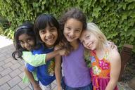 Portrait of four girls hugging - CUF41482