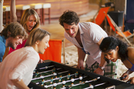 Friends having fun playing table football - CUF41522