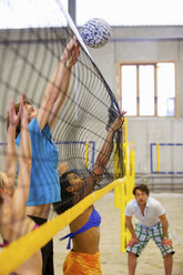 Friends having fun playing indoor beach volleyball - CUF41525