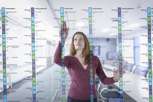Businesswoman in office using interactive screen - CUF41561