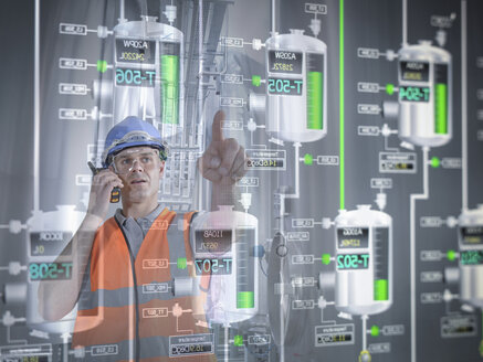 Factory supervisor monitoring product levels on interactive display - CUF41567