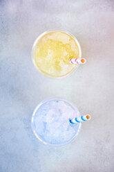 Two plastic cups of melon and blueberry slush - BZF00418