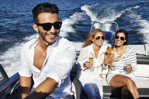 Young adults on boat, Gavle, Sweden - CUF41640
