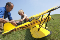 Father and son preparing model plane - CUF41661