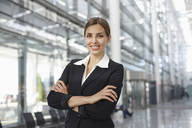 Young businesswoman standing in lobby, portrait - CUF41847