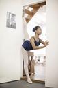 Portrait of teenage ballerina in doorway - CUF41902