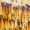 Streaks of rust from steel bolts on a metal sheet. L - MINF00027
