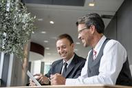 Two businessmen looking at digital tablet - CUF42037