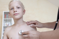 Boy being examining by doctor with stethoscope - CUF42094