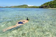 Woman snorkelling, Yasawa island group, Fiji, South Pacific islands - CUF42148