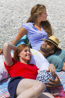 Three friends relaxing on holiday - CUF42202