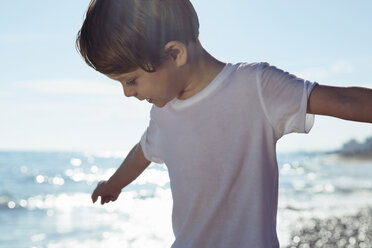 Boy with arms outstretched on beach - CUF42220