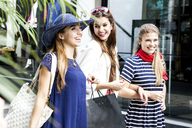 Female friends going shopping together - CUF42286