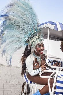Samba dancer riding cart, Rio De Janeiro, Brazil - CUF42331