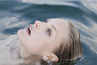 Close up portrait of young woman submerged in lake - CUF42343