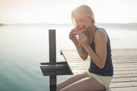 Portrait of young woman eating watermelon - CUF42346