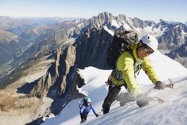 Mid adult couple mountaineering, Chamonix, Haute Savoie, France - CUF42367