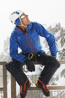Portrait of man wearing climbing helmet looking up - CUF42391