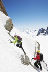 Two people mountain climbing, Chamonix, France - CUF42394