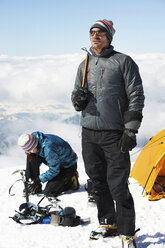 Mid adult couple by tent, Chamonix, France - CUF42400