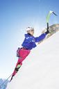 Female mountain climber using ice pick - CUF42421
