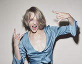 Portrait of blond woman wearing evening dress gesturing - PNEF00729