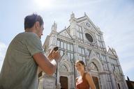 Man and woman outside Church of Santa Croce, Piazza di Santa Croce, Florence, Tuscany, Italy - CUF42651