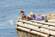 Family fishing on pier, Utvalnas, Gavle, Sweden - CUF42672