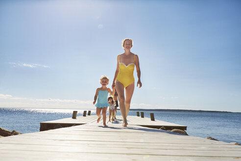 Family walking on jetty, Utvalnas, Gavle, Sweden - CUF42681