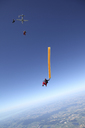 Skydivers free falling with air tube above Leutkirch, Bavaria, Germany - CUF42702