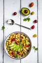 Bowl of bulgur salad with bell pepper, tomatoes, avocado, spring onion and parsley - SARF03830