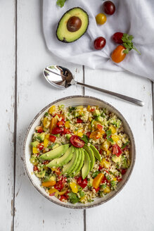 Bowl of bulgur salad with bell pepper, tomatoes, avocado, spring onion and parsley - SARF03833