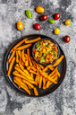 Homemade sweet potato fries and bowl of tomato basil dip - SARF03848