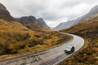 UK, Scotland, scenic road through the mountains in the Scottish highlands near Glencoe with a view on the Three Sisters - WPEF00678